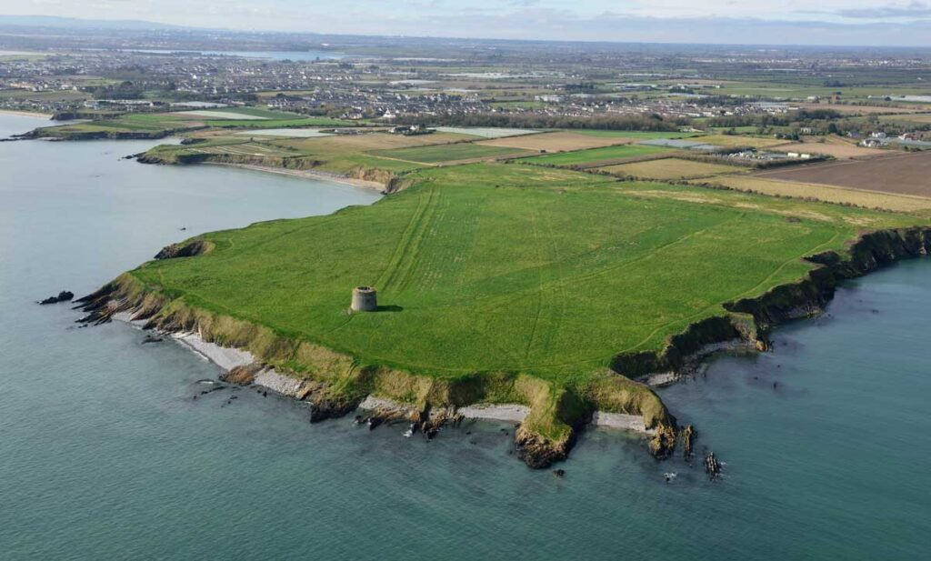 Oblique aerial image the promontory fort at Drumanagh looking south west