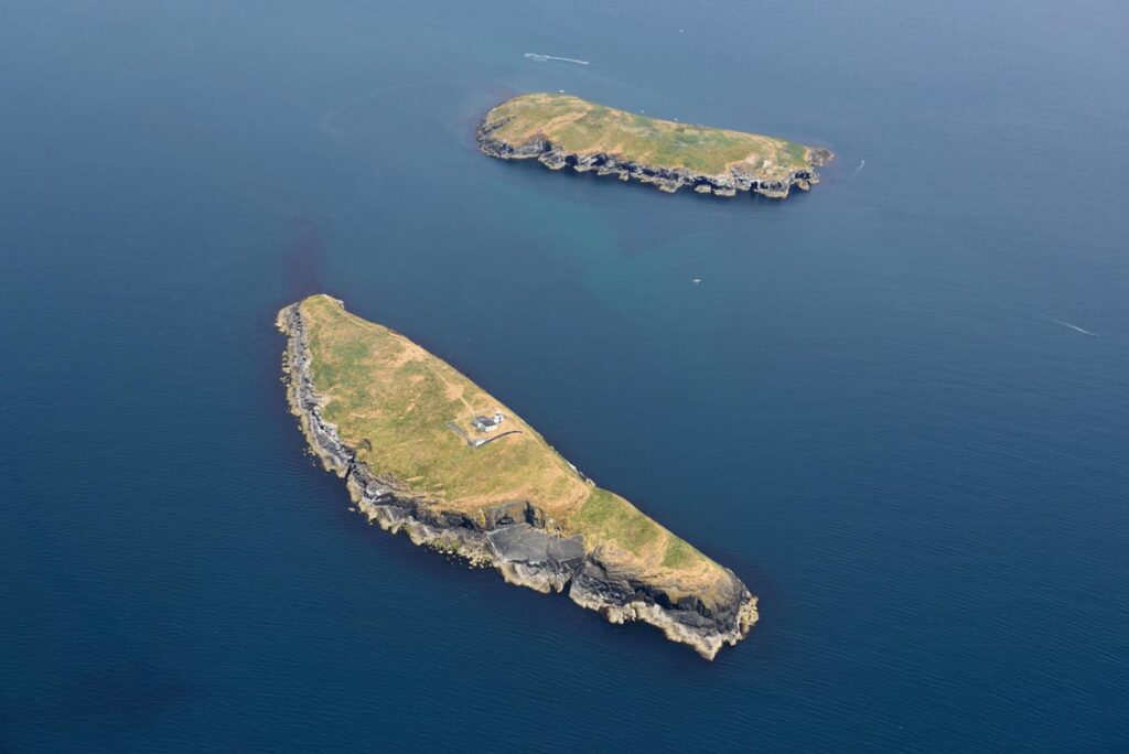 Aerial photograph of St Tudwal's West (foreground) and East (background).