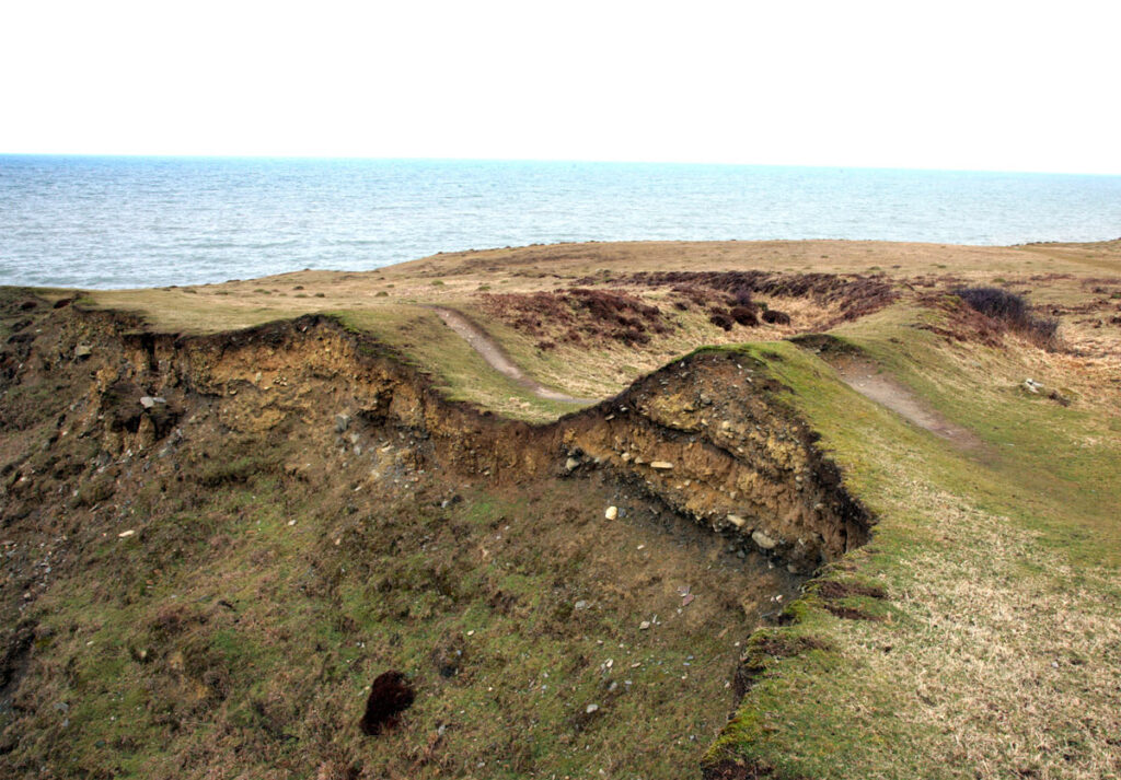Visible erosion of the western side of Castell Bach's defences.