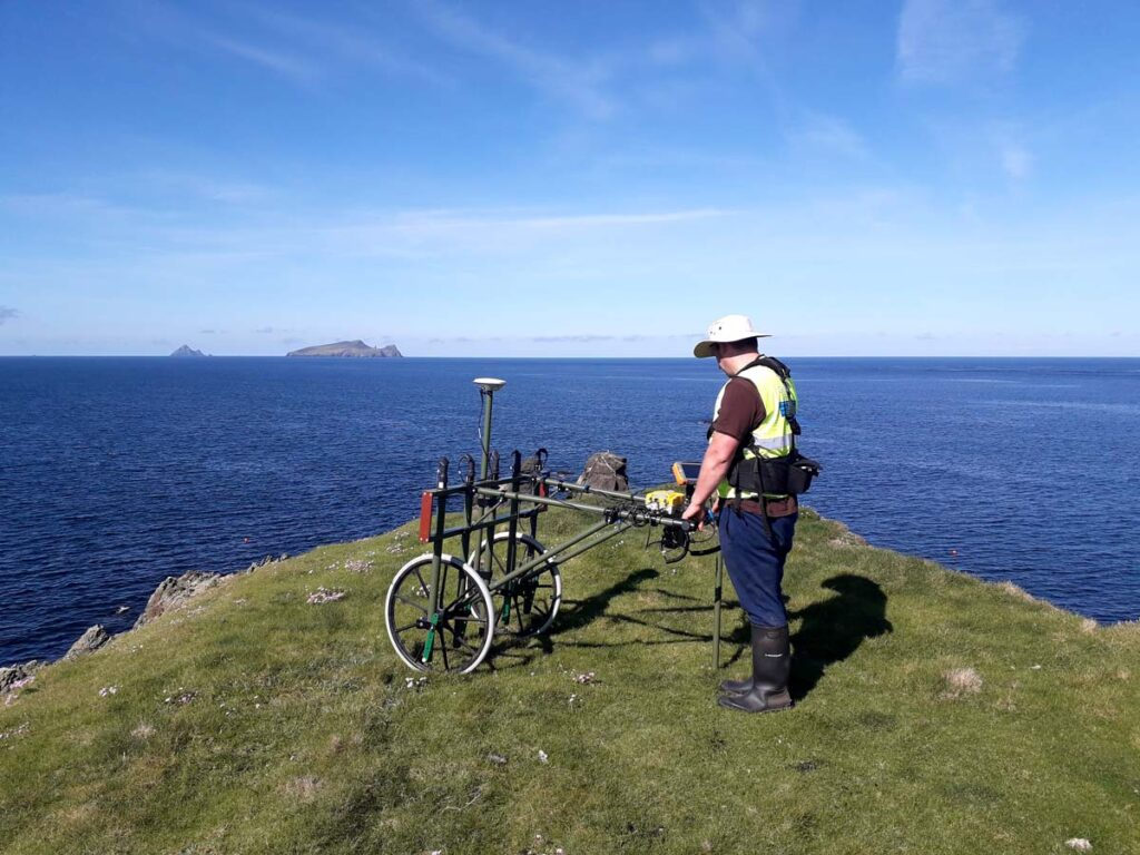Project archaeology Ted Pollard carrying out a geophysical survey of the site in 2019.