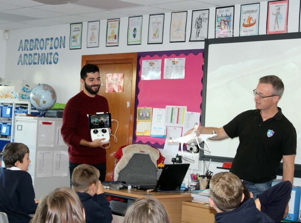 CHERISH Project archaeologists Dan Hunt & Toby Driver demonstrate to a school how drones are used to record archaeological sites.