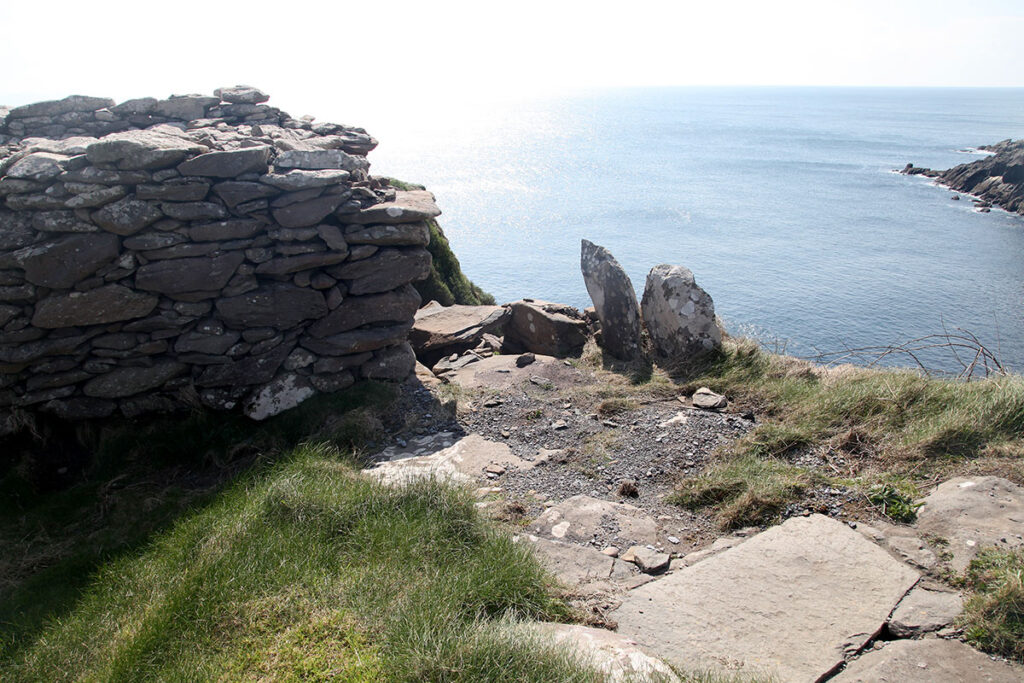 Photograph of Dunbeg in April 2019 showing collapse entrance through the rampart
