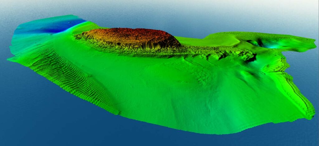 Seamless onshore-offshore map of Puffin Island. 2 x vertical exaggeration. Red is high elevation, changing towards blue for deeper areas