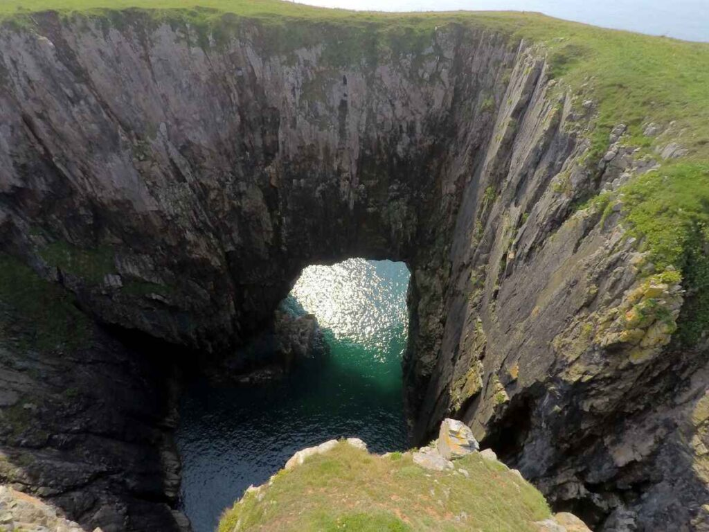 6m pole photography with a GoPro of the 'Cauldron' blowhole inside Flimston promontory fort