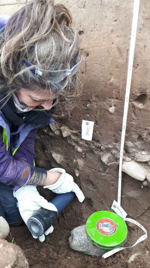 Helen extracting a luminesence sample from a ditch features within the interior of the fort. The sample was taken near to where an interesting iron object was found.